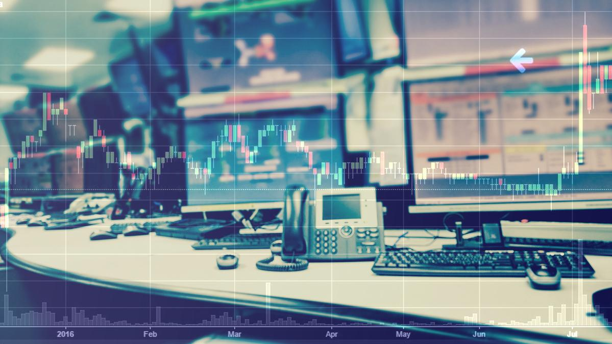 business stock trading room with computer and graph