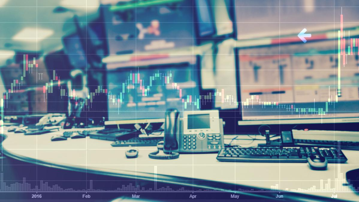 Business Stock Trading room with computer and graphs